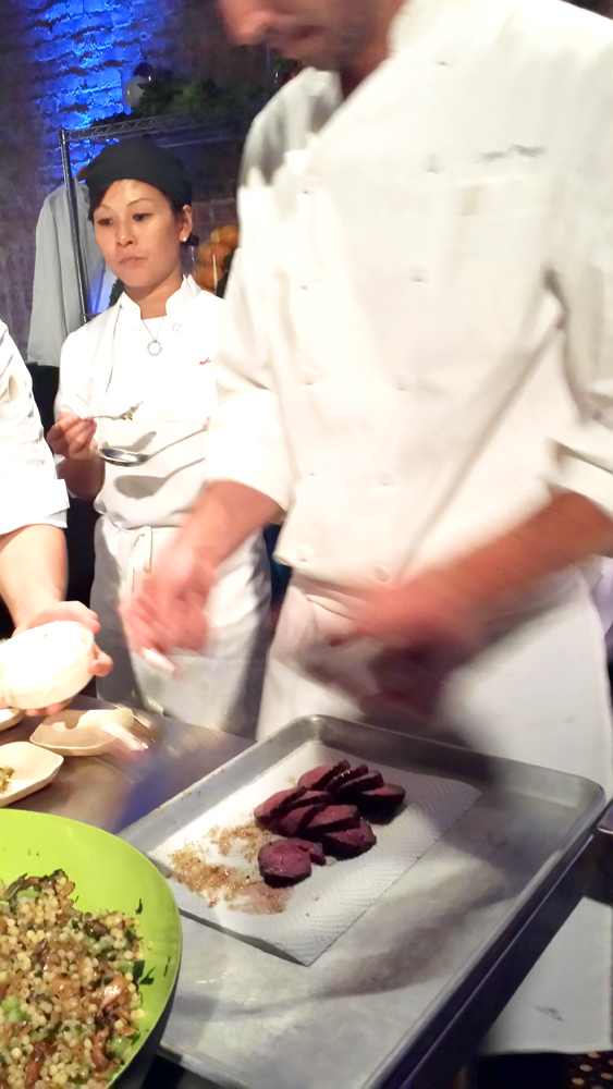 Jorel plating the slices of skirt steak terrines. Look at those juicy pink medallions!