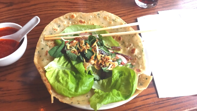 constructing a duck ssam on a scallion pancake
